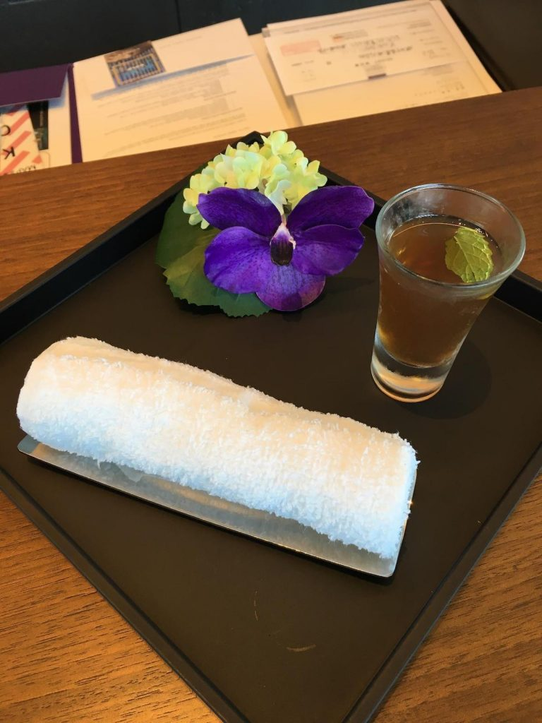 Conrad Osaka welcome drink and cold towel